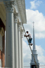 Sergio Ramirez of Painter's Pride works on the columns at the First Parish in Framingham. The meeting house was refurbished after a year long fund raising effort.  The steeple pictured is from the Plymouth Church across the street.Daily News Staff Photo/Art Illman