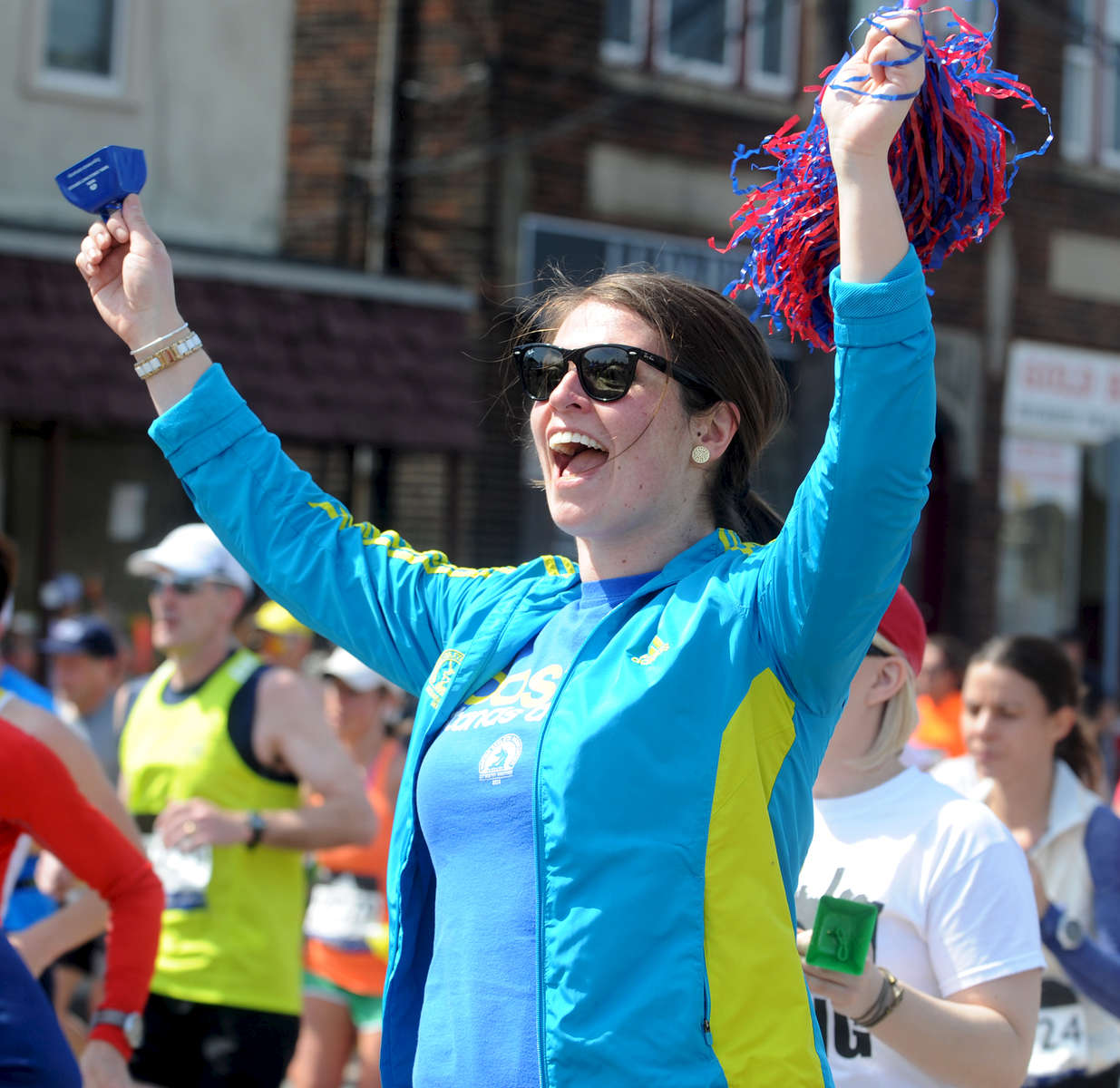 4/18/16-- FRAMINGHAM-- Annie Huppert of Cambridge cheers on runner Cristina Lowry, the sister of an old roommate, in  downtown Framingham Marathon Monday.Daily News and Wicked Local Staff Photo/Art Illman