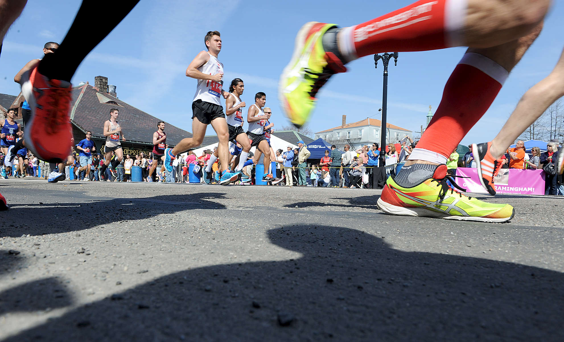 4/18/16-- FRAMINGHAM-- Marathoners in downtown Framingham Monday.Daily News and Wicked Local Staff Photo/Art Illman