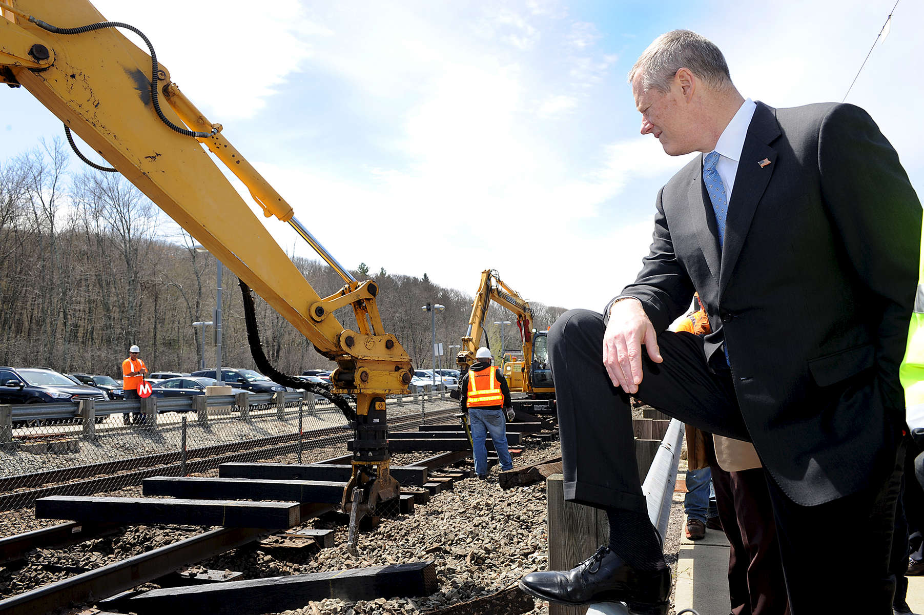 4/28/16-- ASHLAND--  Gov. Charlie Baker at the Ashland Commuter Rail station Thursday, where a Keolis crew was replacing rail ties on the Framingham-Worcester line.Daily News and Wicked Local Staff Photo/Art Illman