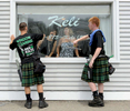 7/7/16-- FRAMINGHAM-- {quote}dressed to kilt{quote}Men in Kilts Window Cleaners Evan Kutz, 20, of Hopkinton, left, and Kyle Booth, 19, of Ashland, seem to meet the approval of hair stylists Natalie Anthony, left, and Cindy Wyman, at Keli in Framingham Centre.Daily News and Wicked Local Staff Photo/Art Illman