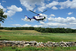 7/19/16-- SOUTHBOROUGH-- UMass Memorial Lifeflight lands at Chestnut Hill Farm Tuesday afternoon to transort a car crash victim.Daily News and Wicked Local Staff Photo/Art Illman
