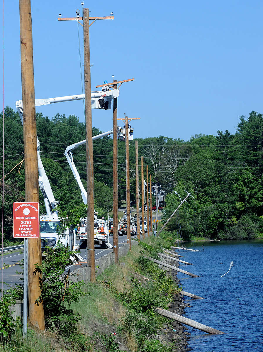 7/23/16  SOUTHBOROUGH-- Crews arrived at 4:30 a.m. Saturday on the Boston Road (Rte.30) causeway to replace utility poles toppled into the Sudbury Reservoir in Friday night's storm.Daily News and Wicked Local Staff Photo/Art Illman