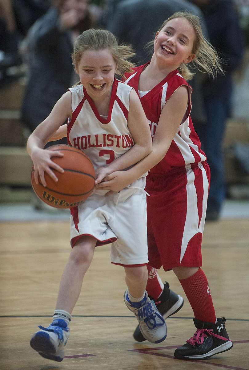 1/25/19-- HOLLISTON--   Holliston fourth graders Emma Kampersal, left, and Grace Schoenberg battle for the ball during halftime at a varsity girls game Friday night at Holliston High School.   [Daily News and Wicked Local Staff Photo/Art Illman]