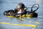 2/6/19-- CONCORD-- Mass. State Police Sgt. Tony Vorias surfaces in the middle of Walden Pond Wednesday.  The State Police Underwater Recovery Unit was conducting ice dive training. The ice was six inches thick.   [Daily News and Wicked Local Staff Photo/Art Illman]