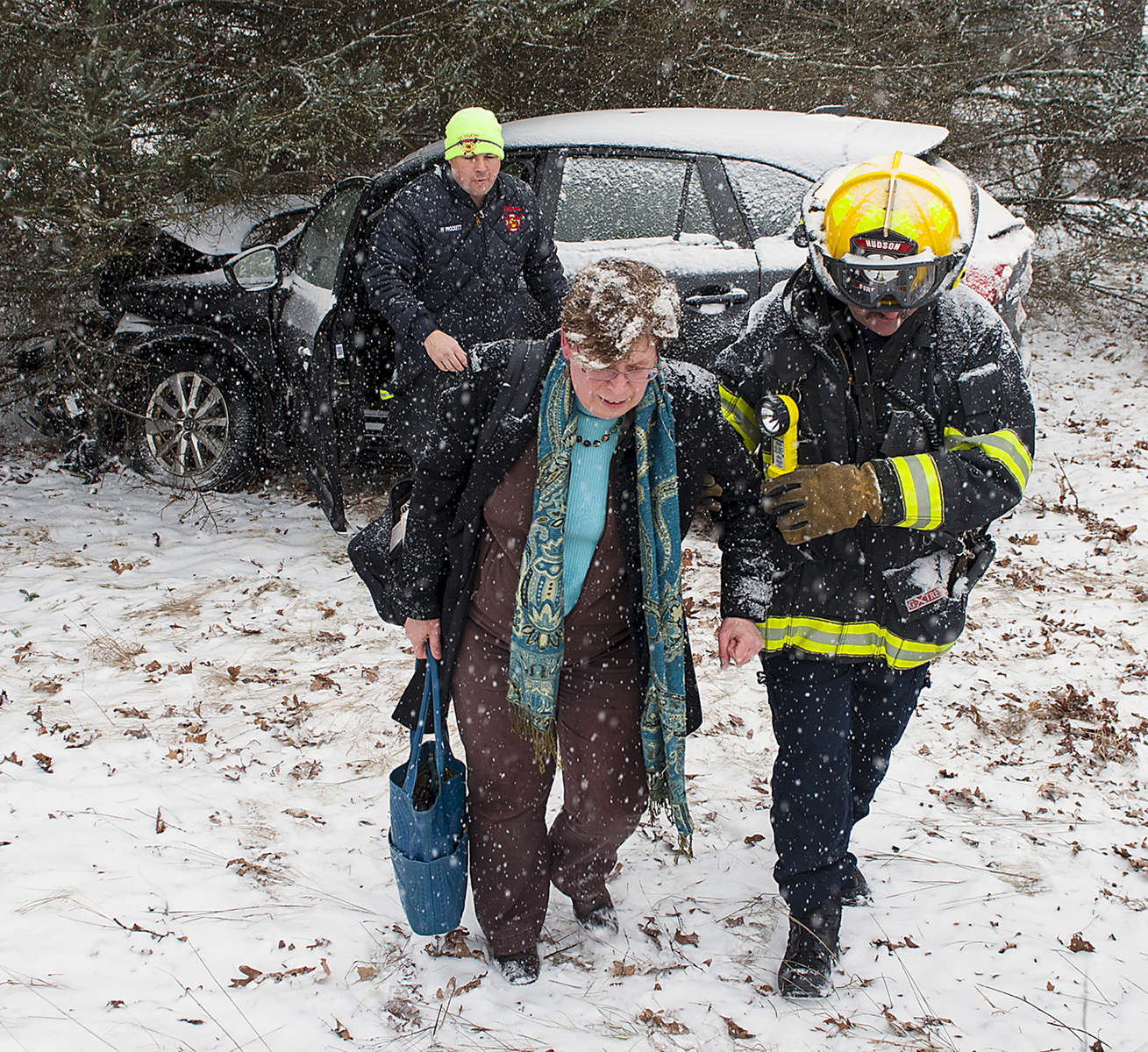2/12/19-- HUDSON--   Hudson Fire Lt. Erick Currin, right, and Police Officer Peter Lambert assist a passenger from a car involved in crash on Main Street at Lewis Street Tuesday afternoon.  There were no injuries.  Both vehicles were towed from the scene. [Daily News and Wicked Local Staff Photo/Art Illman]