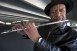 3/27-19-- FRAMINGHAM-- Minor Bird Davis was playing 12-tone spirals on his flute, on the lower level of a parking garage on Grant Street Wednesday afternoon.  [Daily News and Wicked Local Staff Photo/Art Illman]