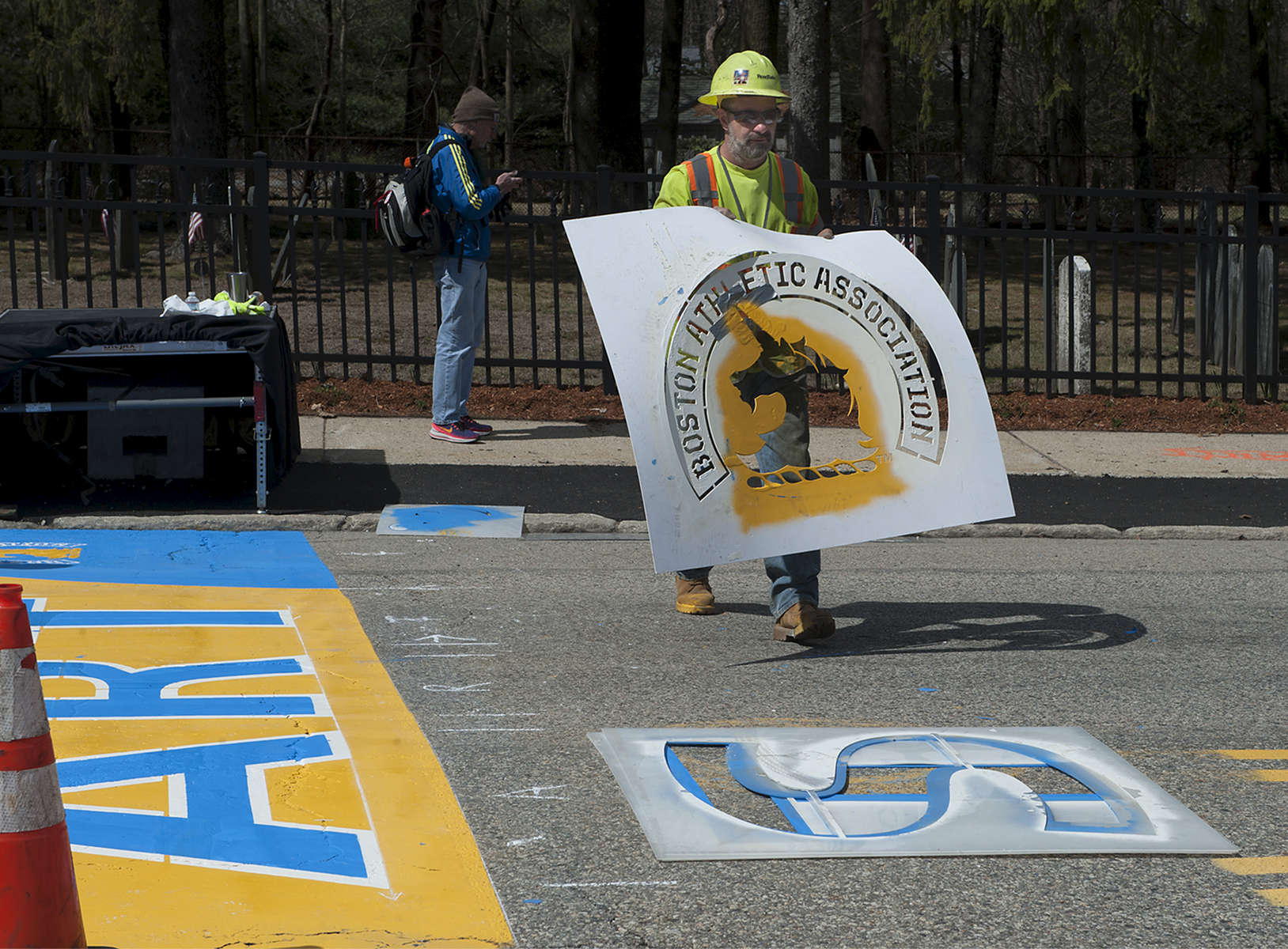 4/11/19-- HOPKINTON-- Will Belazoos of Road Safe Traffic Systems with Connor Freitas, not pictured, painted the starting line Thursday for the 123rd running of the Boston Marathon on Monday, April 15.   [Daily News and Wicked Local Staff Photo/Art Illman]