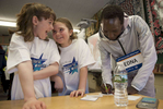4/11/19-- HOPKINTON-- At the 27th annual John Hancock Scholars and Stars pre-Boston Marathon pep rally at the Elmwood Elementary School on Thursday, third graders from Tom Keane's class,  Lilly Donovan, left, and Leah Colvin, react as 2017 Boston Marathon womens winner Edna Kiplagat writes down her personal email for the girls so they can stay in touch.  [Daily News and Wicked Local Staff Photo/Art Illman]
