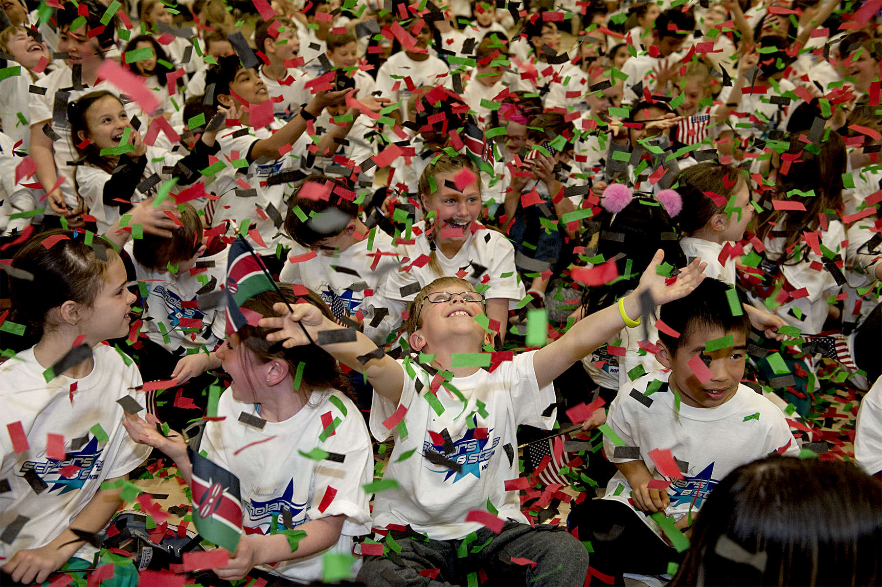 4/11/19-- HOPKINTON-- At the conclusion of the 27th annual John Hancock Scholars and Stars pre-Boston Marathon pep rally at the Elmwood Elementary School on Thursday, third grader Danny Johnson, center, and classmates enjoy a shower of confetti.  [Daily News and Wicked Local Staff Photo/Art Illman]