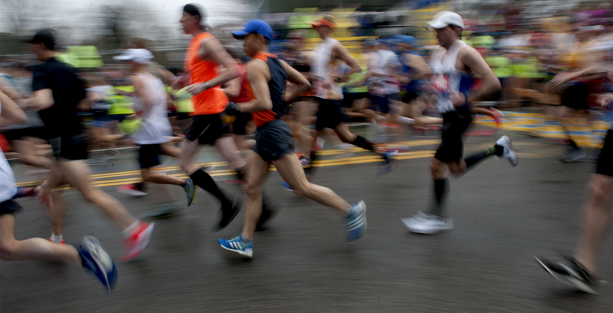 4/15/19--HOPKINTON-- A slow shutter speed blurs the start of the 123rd running of the Boston Marathon. [Daily News and Wicked Local Staff Photo/Art Illman]