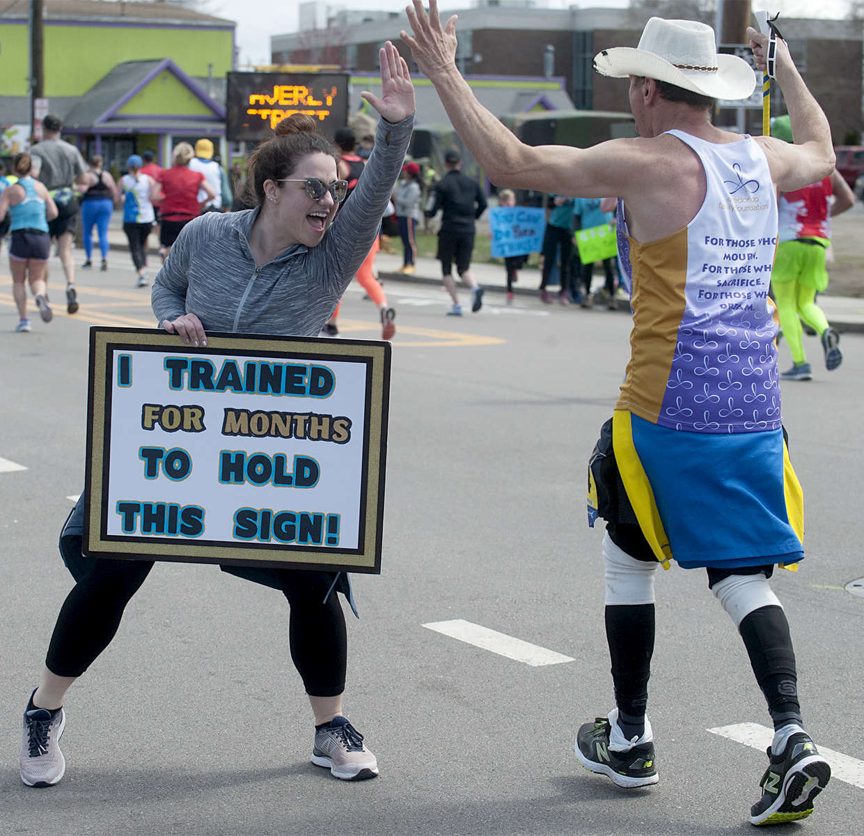4/15/19-- FRAMINGHAM-- Ashley Ginther of Reading, PA was in Framingham shouting {quote}You're awesome{quote} to passing Boston Marathon runners. [Daily News and Wicked Local Staff Photo/Art Illman]