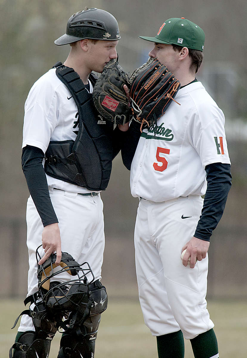 4/12/19-- ASHLAND---   Conference on the mound. Hopkinton starting pitcher Josh Fischer  and catcher Ronnie Shamus against Ashland Friday afternoon. [Daily News and Wicked Local Staff Photo/Art Illman]