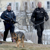 3/21/17-- MARLBOROUGH-- Marlborough Police Officers Robert Bonina, left, and Kenneth McKenzie, and K-9 Kaiser, search for three armed suspects on Lincoln Street Tuesday morning after a reported home invasion.[Daily News and Wicked Local Staff Photo/Art Illman]