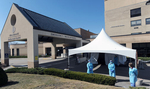 3/26/20-- MARLBOROUGH--  At UMass Memorial Marlborough Hospital on Thursday, registered nurses wait to test people for COVID-19 outside a tent placed next to the main entrance. The hospital is testing people for the coronavirus with a physician's order, Monday through Saturday, 10 a.m. to 4 p.m., and on Sunday, 10 a.m. to 2 p.m. They are averaging about 30 tests per day, as of Thursday.  While urgent and emergent care is still available at the hospital, there are no elective outpatient services at this time. [Daily News and Wicked Local Staff Photo/Art Illman]