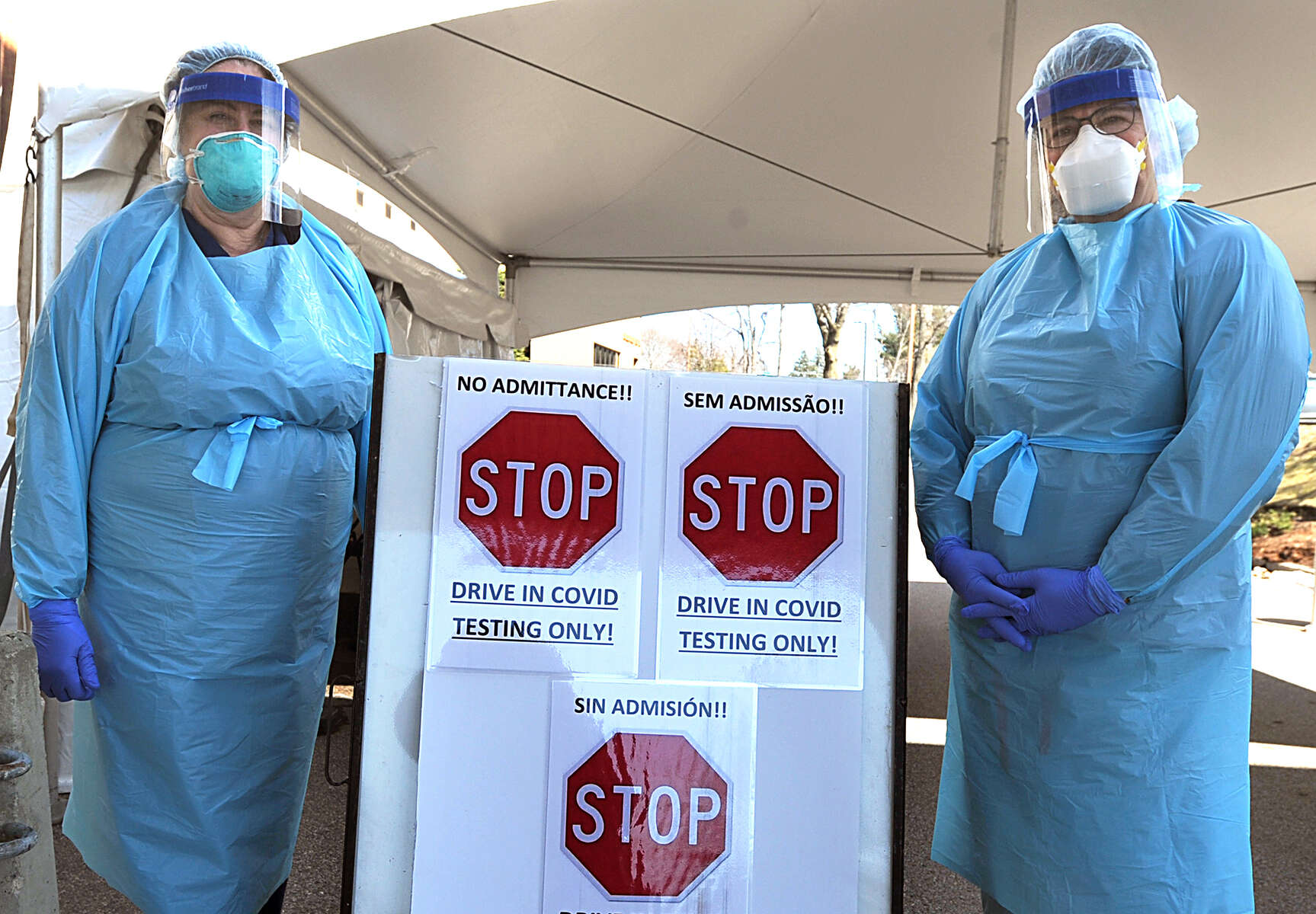 3/26/20-- MARLBOROUGH--  At UMass Memorial Marlborough Hospital on Thursday, registered nurses Becky Clarey, left, and Christine Howard wait to test people for COVID-19, outside a tent placed next to the main entrance. The hospital is testing people for the coronavirus with a physician's order, Monday through Saturday, 10 a.m. to 4 p.m., and on Sunday, 10 a.m. to 2 p.m. They are averaging about 30 tests per day, as of Thursday.  While urgent and emergent care is still available at the hospital, there are no elective outpatient services at this time. [Daily News and Wicked Local Staff Photo/Art Illman]