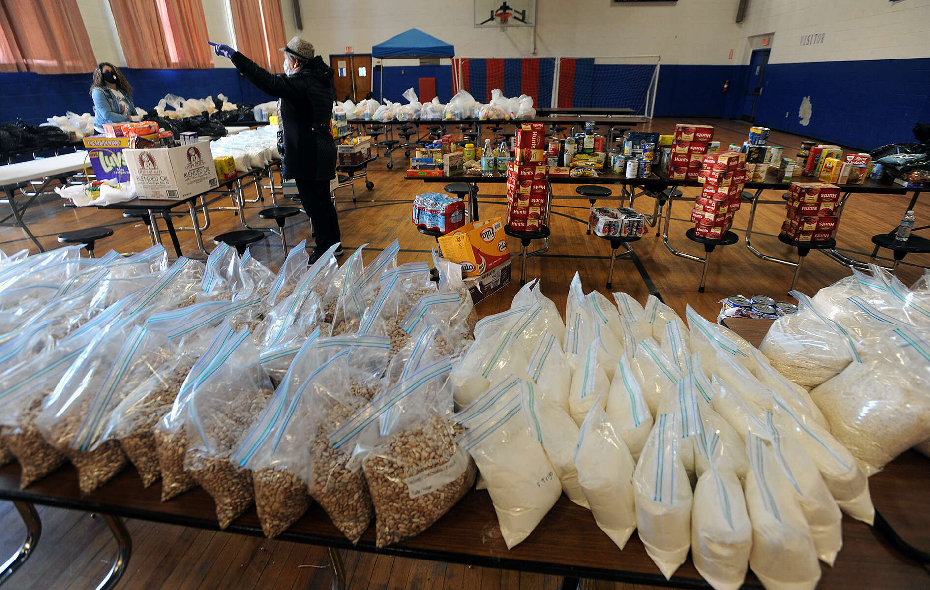 4/17/20-- FRAMINGHAM-- Inside the Brazilian American Center on Waverly  Street,  bags of beans and flour frame other food at the two-week old food distribution center.  They are serving 321 families as of Friday.  The hours are 9 a.m. to 12 p.m. Wednesday and Fridays. [Daily News and Wicked Local Staff Photo/Art Illman]