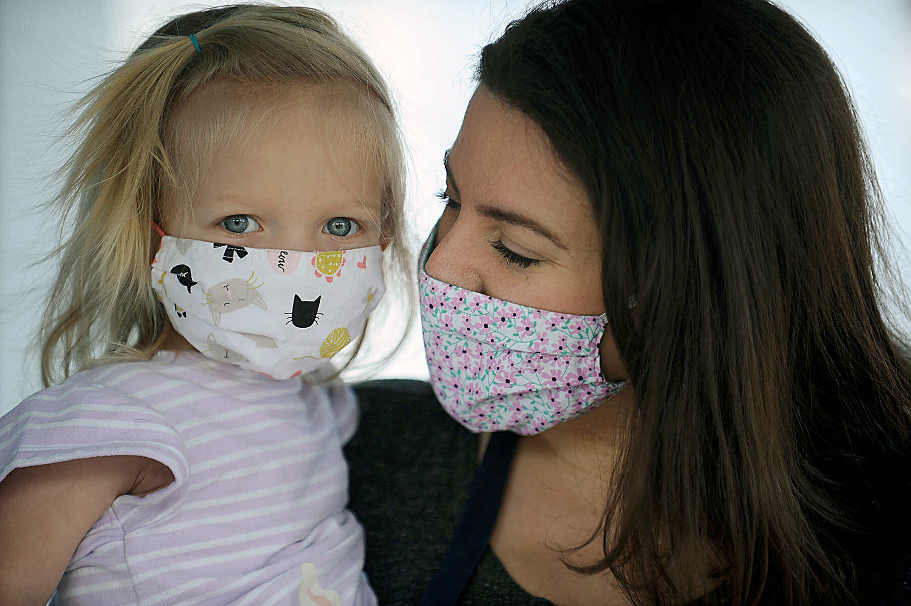 5/5/20-- NATICK--  Jess Blazejewski with her one-year-old daughter, Lila. Blazejewski's Natick porch is the drop off and pick up location for Massachusetts Face Shield, started by her, her mother, and sister to help solve the PPE shortage for front line health care workers fighting COVID-19. So far they have donated 1,657 face shields statewide. Their goal is 15,000.   [Daily News and Wicked Local Staff Photo/Art Illman]