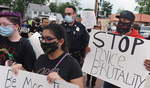 6/3/20-- FRAMINGHAM-- Participants march during a Black Lives Matter rally Wednesday which began at the Framingham Village Green, went to City Hall, and back. Several police officers marched with the group, including School Resource Officer Jay Ball, pictured. [Daily News and Wicked Local Staff Photo/Art Illman]
