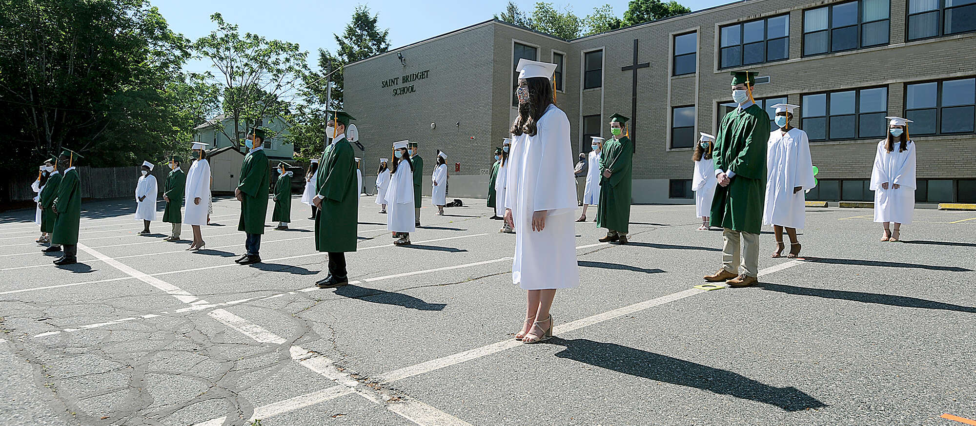 6/4/20-- FRAMINGHAM-- Saint Bridget School held a physically distanced outdoor graduation for 27 eighth grade graduates Thursday morning. [Daily News and Wicked Local Staff Photo/Art Illman]