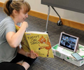 6/26/20-- FRANKLIN-- Inside the Franklin Public Library,  Assistant Youth Services Librarian Bree Comeau reads to children on zoom during the Happy Feet Creative Movement and Dance Class Friday morning.  She has as many as 15 youngsters taking part. The library has instituted curbside pickup and drop off, but the library itself remains closed to the public due to the coronavirus. [Daily News and Wicked Local Staff Photo/Art Illman]