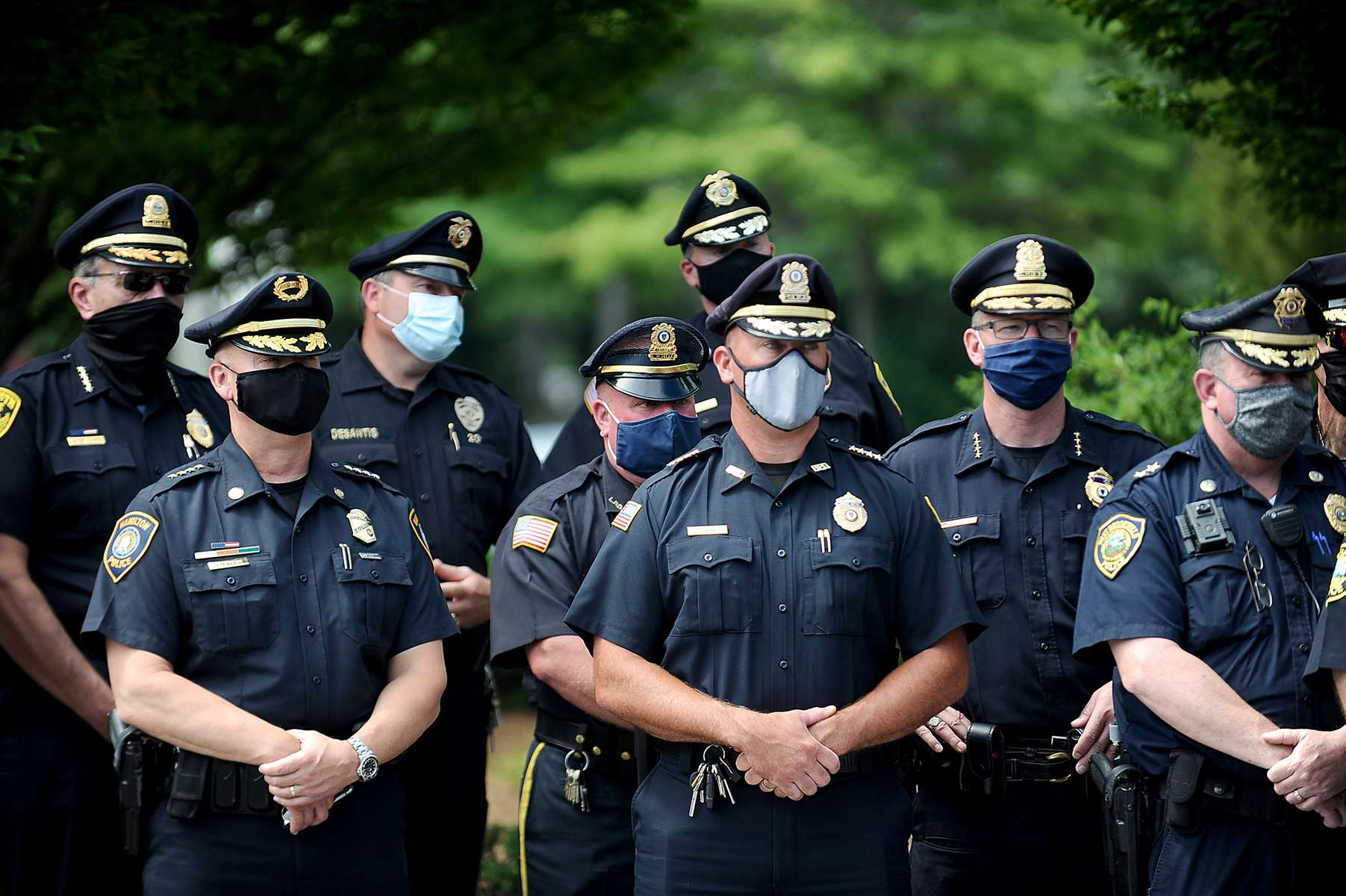 7/21/20-- FRAMINGHAM-- Dozens of police chiefs attended a rally addressing proposed state police reform bills.  The rally was held at an otherwise empty AMC Movie theatre parking lot Tuesday morning. [Daily News and Wicked Local Staff Photo/Art Illman]