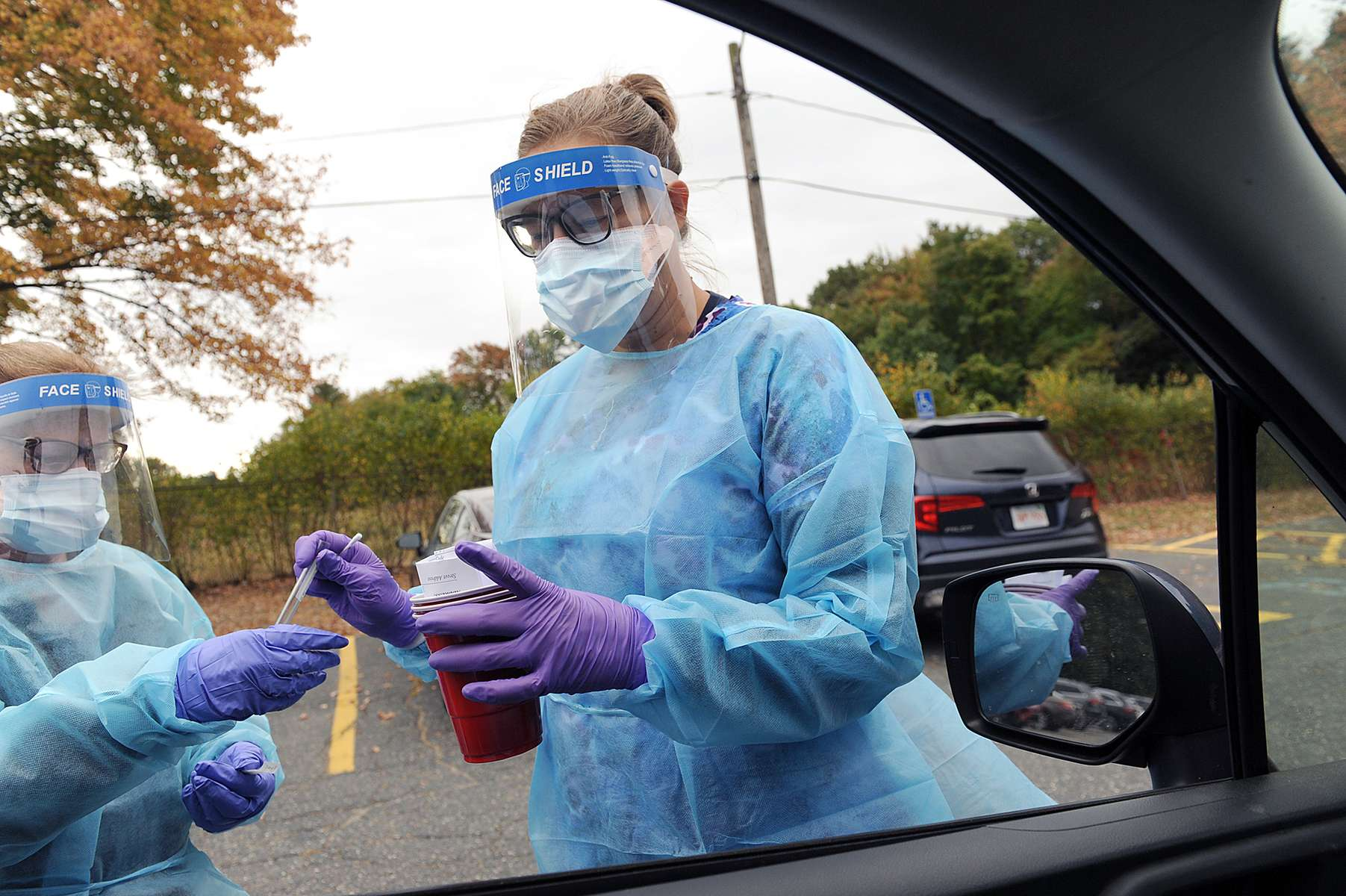 10/2/20— FRAMINGHAM— Registered Nurse Loren Prather prepares to give a COVID-19 test at the Walsh Middle School, the newest  location for drive-through free COVID testing administered by Fallon Ambulance.  The drive through at 301 Brook St. is open Monday-Saturday, 9 a.m. to 1 p.m.  Free walk-up tests are available at South Middlesex Opportunity Council (SMOC) 7 Bishop St. Monday, Wednesday and Friday, 3-6 p.m., and at the Amazing Things Art Center, 160 Hollis St., Tuesday and Thursday, 3-6 p.m.  [Daily News and Wicked Local Staff Photo/Art Illman]