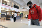 10/15/20- MILFORD - At Milford High School, students use hand sanitizer upon entering the building, and masks are provided for students who do not have one.  [Daily News and Wicked Local Staff Photo/Art Illman]