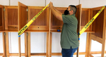 Marlborough Elections Clerk Leo Mercado tapes off every other voting booth Monday at the Senior Center voting place, getting ready for Tuesday's election. [Daily News and Wicked Local Staff Photo/Art Illman]