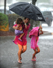 8/1/14-- FRAMINGHAM--  Michelle Marseglia with Alyssa, 3, and Avery, 6, of Ashland,  running through the rain at the Temple Street Stop and Shop parking lot Friday afternoon.Daily News Staff Photo/Art Illman