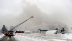 Firefighters pump water on a barn fire at the Hillside School farm in Marlborough, Feb. 2, 2021.