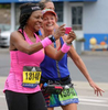 Sandra Tezino, left, and Trudy Regnier, both of Texas, left,  pause in Framingham for a selfie during the running of the 125th Boston Marathon, Oct. 11, 2021.