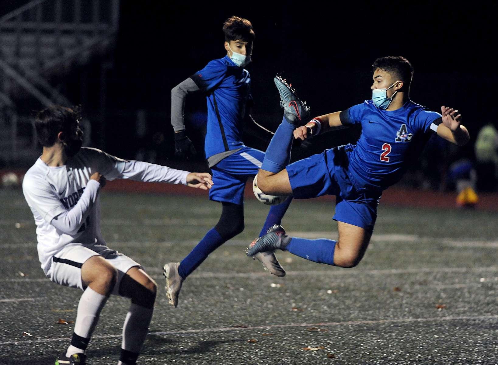 Ashland High School soccer player Shea Donovan goes airborne against Norton Nov. 13, 2020.
