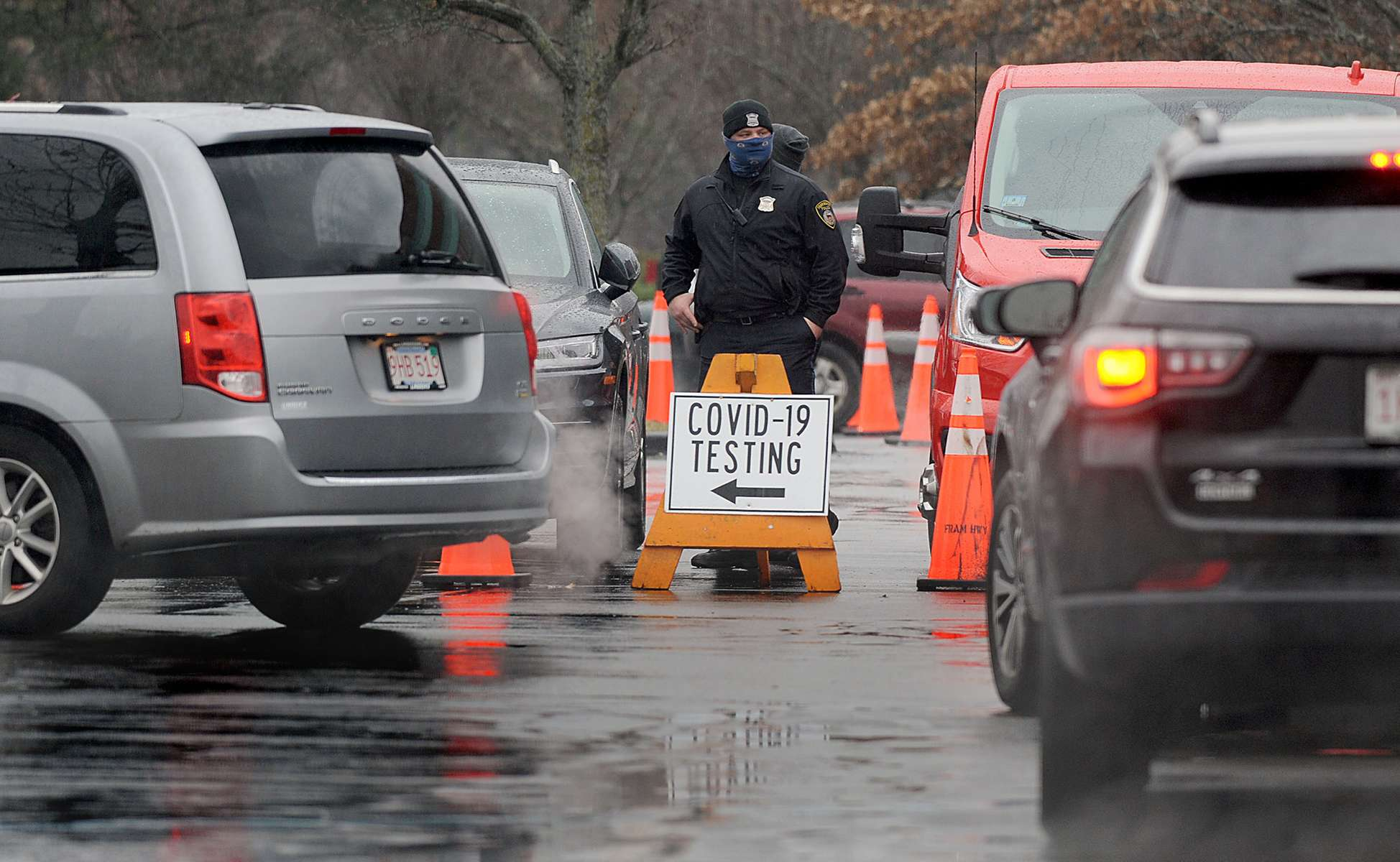 Cars snake their way through the TJX parking lot for COVID-19 testing Nov. 30, 2020 in Framingham.