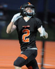 Wayland High School Football senior William Carr locks in on a passduring the 39-36 comeback win against Holliston, April 23, 2021.