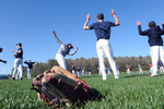 Lincoln-Sudbury Regional High School baseball players stretch on the first day of spring practice, April 26, 2021.