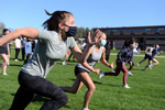 Lincoln-Sudbury Regional High School track team freshmen Katie Drew, left, and Amber Stubblebine run sprints on the first day of spring practice, April 26, 2021.