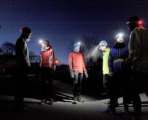 2/12/14-- HOPKINTON-- for scott o storyMembers of the Hopkinton Running Club gather for their 6 a.m. run despite a temperature of zero degrees Wednesday. From left: Mike Barry, Maureen Tumbleton, Jonathan Meltzer, Jon Lurie, Michelle Kinsella, and Joe Markey.Daily News Staff Photo/Art Illman