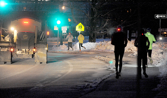 2/12/14-- HOPKINTON-- for scott o storyMembers of the Hopkinton Running Club on their 6 a.m. run despite a temperature of zero degrees Wednesday.Daily News Staff Photo/Art Illman