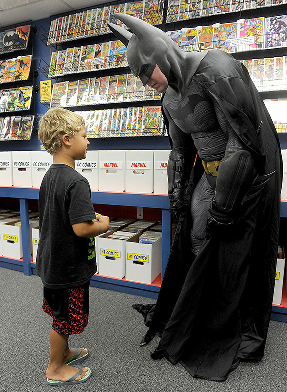 7/23/14-- SOUTHBOROUGH--  At The Hall of Comics in Southborough, Camron Toth-Davila, 4, of Framingham, speakd with Batman, (Spencer Doe), at Batman Day at the new comic book store. Dozens of fans turned out to celebrate Batman's 75th birthday and to meet Robin, Batgirl, and Nightwing.Daily News Staff Photo/Art Illman