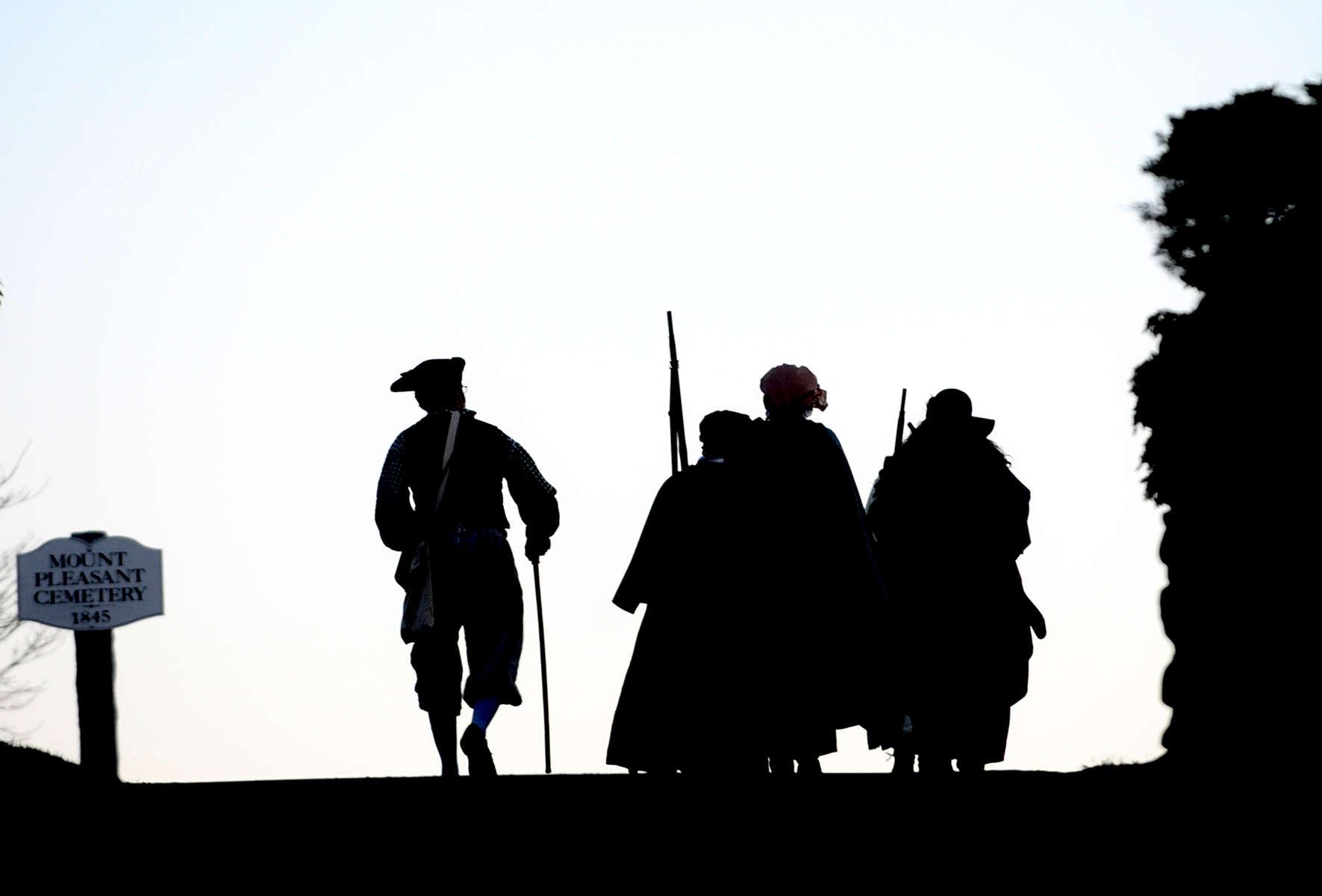 Sudbury's Minute and Militia reenactors march to Concord Patriots Day morning.  Daily News Staff Photo/Art Illman