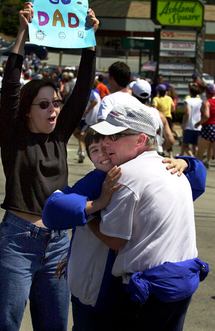 In 2003 Emily Trebat of Ashland  gives her dad, Allan Trebat of New Hampshire, a hug while her mom Jan Bolton, cheers on.