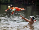 7/20/20-- ASHLAND-- Kaiden Waite, 4, is tossed into the water by dad Eric at the Ashland State Park Beach on Monday. [Daily News and Wicked Local Staff Photo/Art Illman]
