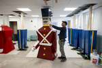 Framingham Highway Dept. Supervisor  Dan Greenwood measures an original Shoppers World wooden toy soldier at the Cushing Maintenance Building last Thursday, where six new soldiers were being constructed. [Daily News and Wicked Local Staff Photo/Art Illman]