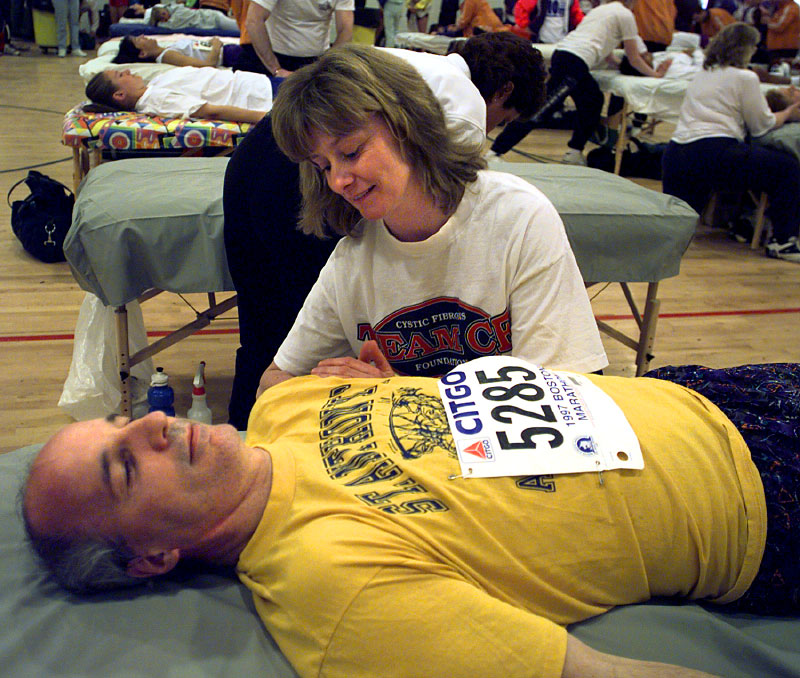 In 1997, Joe Fritsch of New York City gets a massage from certified massage therapist Nancy Bissonnette of Hudson in the Runner's Village at Hopkinton High School.