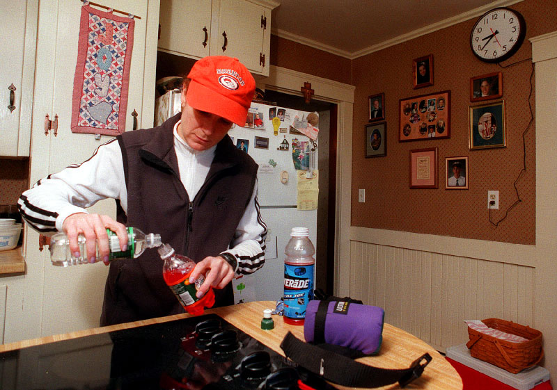 In 1999,  Ellen Riley of Westborough mixes water with gatorade in the Hopkinton home of her husband's aunt and uncle.