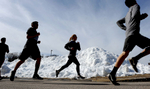 3/20/17-- MILFORD-- Boys and girls track teams ran loops around the snow lined parking lot of the high school on the first day of Spring practice on he first day of Spring.[Daily News and Wicked Local Staff Photo/Art Illman]