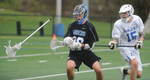 5/2/17-- ASHLAND- Ashland's C. Dunn slashes the stick with ball in tact out of the gloves of Dover Sherborn's Jack Dillon Tuesday. [Daily News and Wicked Local Staff Photo/Art Illman]