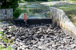 8/17/16 CONCORD-- Alison Field-Juma, executive director of OARS, at Warner's Pond in West Concord Wednesday, at a dry spillway.Daily News and Wicked Local Staff Photo/Art Illman