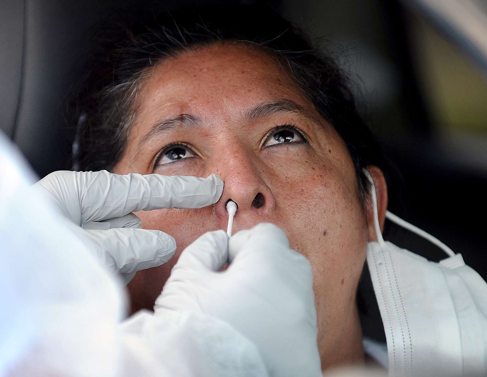 8/5/20-- FRAMINGHAM--  Sara Salazar, of Framingham,  receives a free, state sponsored COVID-19 nasal swab test from her car in the parking lot of the Joseph P. Keefe Technical High School Wednesday.  Hundreds of cars were lined up for the tests, which began at 2 p.m.  The first car in line arrived at 9 a.m. Tests hours are Monday, Wednesday and Friday, 2-6 p.m. and Tuesday and Thursdays, 8 a.m. to 12.p.m. through August 14. [Daily News and Wicked Local Staff Photo/Art Illman]